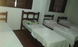 Cama ou camas em um quarto em Hostel Palmas Centro Da Cidade