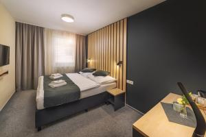 Posteľ alebo postele v izbe v ubytovaní TIMEOUT City Hotel