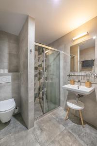 Kúpeľňa v ubytovaní TIMEOUT City Hotel