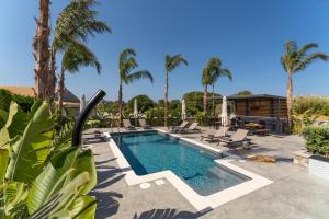 The swimming pool at or near Palmeral Luxury Suites