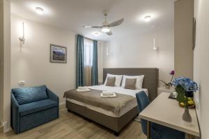 Posteľ alebo postele v izbe v ubytovaní COR ROOMS