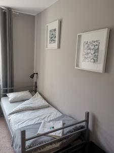 Łóżko lub łóżka w pokoju w obiekcie Bemma Apart Hostel