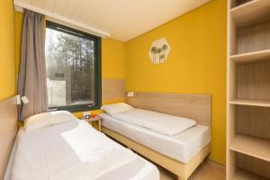 Ein Bett oder Betten in einem Zimmer der Unterkunft Center Parcs Bispinger Lüneburger Heide