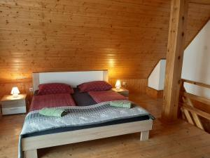 A bed or beds in a room at Apartments Rupnik