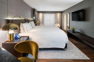 A bed or beds in a room at Sofitel Bogota Victoria Regia