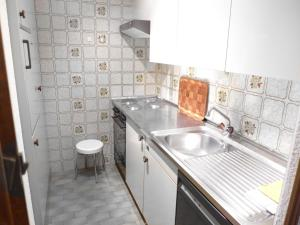 A kitchen or kitchenette at Apartment Les Faverges-1