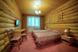 Кровать или кровати в номере Отель Семигорье