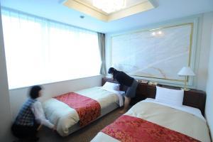 Een bed of bedden in een kamer bij Hotel Sunny