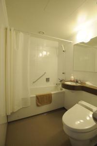 Een badkamer bij Hotel Sunny