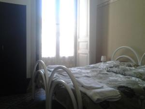 Ein Bett oder Betten in einem Zimmer der Unterkunft Sisto House