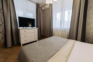 Телевизор и/или развлекательный центр в City Hotel