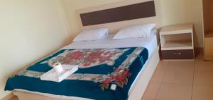 A bed or beds in a room at Mas Cottages