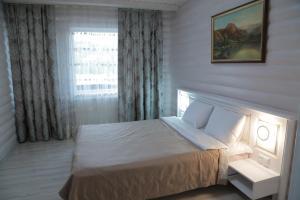 A bed or beds in a room at Villa Leku SPA Resort