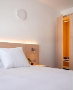 Een bed of bedden in een kamer bij Barcarola Club