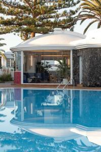Het zwembad bij of vlak bij Barcarola Club