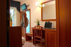 A television and/or entertainment center at Hotel Jole