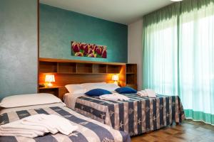 Кровать или кровати в номере Hotel Parco dei Pini