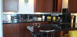 A kitchen or kitchenette at Captivating 1-Bed Apartment sea views in innellan