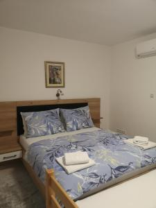 Meje Apartmentsにあるベッド