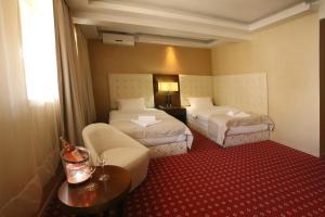 Krevet ili kreveti u jedinici u okviru objekta Orbis Design Hotel & Spa