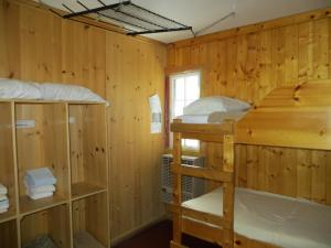 A bunk bed or bunk beds in a room at HI Rampart Creek Hostel