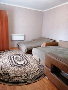 Кровать или кровати в номере Гостевой дом на Полевой
