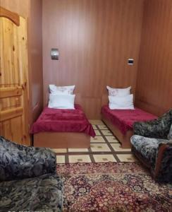 Кровать или кровати в номере Guesthouse Sofia