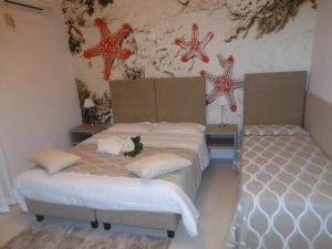 Un ou plusieurs lits dans un hébergement de l'établissement Oasi Verde