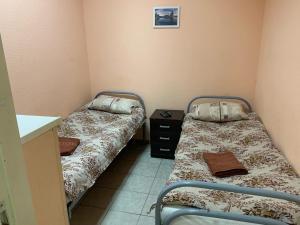 Кровать или кровати в номере Хостел Древний Псков