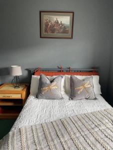 A bed or beds in a room at The Dornie