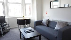 A seating area at Sienna Family Holiday Apartments