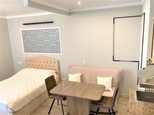Гостиная зона в Apartment Siyanie Sochi