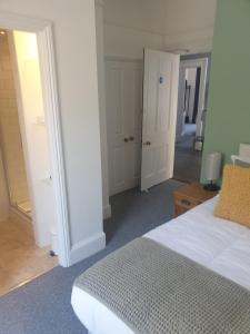 A bed or beds in a room at The Tavistock Hotel & Inn