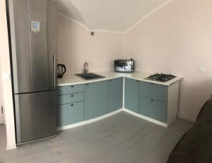 A kitchen or kitchenette at Апартаменты на Почтовой