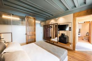 A bed or beds in a room at Domus Renier Boutique Hotel - Historic Hotels Worldwide