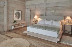 A bed or beds in a room at KiChic