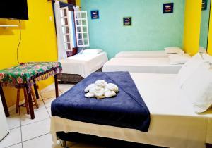 Cama ou camas em um quarto em Pousada Talismã