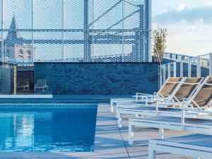 The swimming pool at or near Hotel Mercure Blankenberge Station