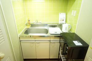 A kitchen or kitchenette at Riviere Dotonbori - Vacation STAY 8022