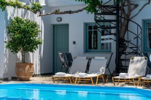 The swimming pool at or near Kurmulis Studios