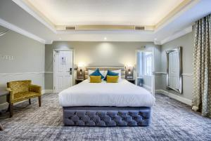 A bed or beds in a room at The Villare Hotel