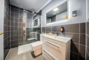 A bathroom at The Villare Hotel