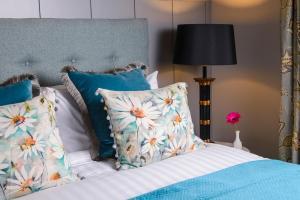 Un ou plusieurs lits dans un hébergement de l'établissement Killarney Dromhall Hotel