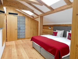 Ein Bett oder Betten in einem Zimmer der Unterkunft Das Achental Resort