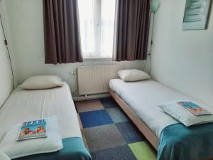 Een bed of bedden in een kamer bij Hotel Friends Texel