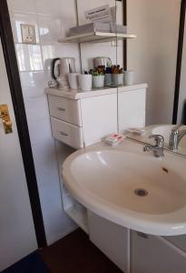 Een badkamer bij Hotel Friends Texel