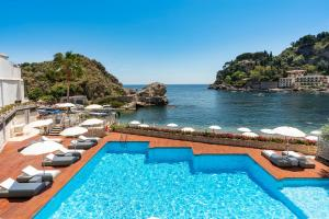 A view of the pool at Mazzarò Sea Palace - VRetreats or nearby