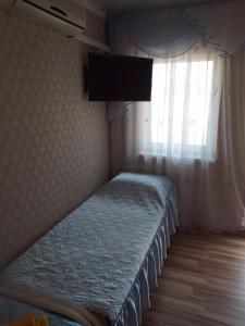 Кровать или кровати в номере Guest house on Pavlova 75