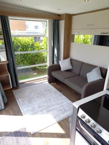 A seating area at The Pod at Mornest Caravan Park, Anglesey