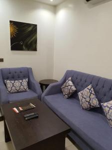 Uma área de estar em Rosa Aparthotel